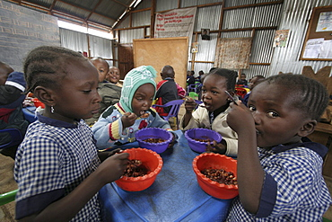 Kenya day care center in kibera slum, nairobi. Meal time at the center