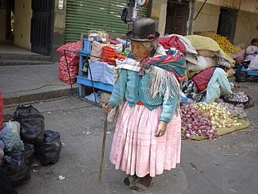 BOLIVIA Street scenes in La Paz. Old woman walking