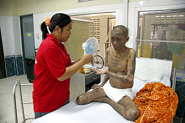 Thailand hiv+ patients in an aids hospice at a buddhist temple in lopburi