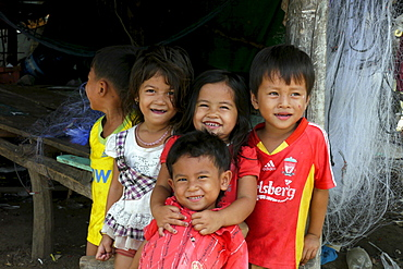 CAMBODIA Group of children. Don Tok village, Kampot, lies beside a river estuary and is often flooded by sea water, a consequence of climate change during the last few years. CRS is studying the problem through its partner agency, SCW (Save Cambodian Wildlife). Local children and families who are being affected by local flooding. photo by Sean Sprague