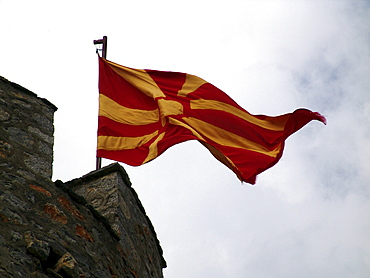 Macedonia (the former yugoslav republic of macedonia, fyrm) national flag flying from castle. The town of ohrid on the shore of lake ohrid