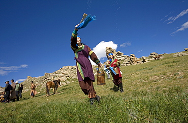 """Horse milk is sprinkled into the four directions, as offerings to the nature spirits of the area, the sadak, or ?owners Of the earth.? Sometimes vodka is used instead, or as well. Milk is sacred to the mongol shamans, who believe that life on earth is descended from beings who originally came here on winged horses. Here two young female shamans make the offering in a ritual manner. Countryside mongols make this offering every morning on waking up; they usually also offer smoke, that the wind carries around the world as a prayer for harmony and prosperity. 13th century national park, tov province, mongolia. 13th century national park comprises chinggis khan's giant statue museum and live museum """"town from 13 century"""". The ancient nomadic mini kingdom is located in the distance of 130 km east of ulaanbaatar in area of erdene zuu of tov province. It takes 2 hours driving on paved road. In the live 13th century kingdom one will see and experience the authentic lifestyle of mongols, who were lived in powerful mongol empire?s Period. This place gives you a same feeling that famous traveler marco polo and william rubruck felt once upon time"""