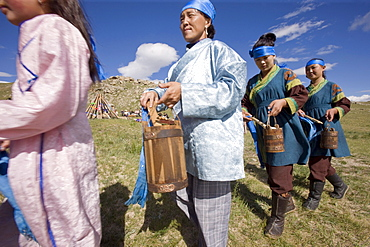 "Horse milk is sprinkled into the four directions, as offerings to the nature spirits of the area, the sadak, or ?owners Of the earth.? Sometimes vodka is used instead, or as well. Milk is sacred to the mongol shamans, who believe that life on earth is descended from beings who originally came here on winged horses. Here two young female shamans make the offering in a ritual manner. Countryside mongols make this offering every morning on waking up; they usually also offer smoke, that the wind carries around the world as a prayer for harmony and prosperity. 13th century national park, tov province, mongolia. 13th century national park comprises chinggis khan's giant statue museum and live museum ""town from 13 century"". The ancient nomadic mini kingdom is located in the distance of 130 km east of ulaanbaatar in area of erdene zuu of tov province. It takes 2 hours driving on paved road. In the live 13th century kingdom one will see and experience the authentic lifestyle of mongols, who were lived in powerful mongol empire?s Period. This place gives you a same feeling that famous traveler marco polo and william rubruck felt once upon time"