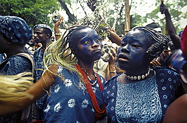 Yoruba women dance in trance at a sacred water festival to honor their animistic spirits. nigeria, africa