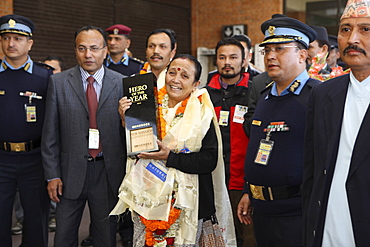 Anuradha Koirala holds up her CNN Hero of the Year 2010 award as she is warmly greeted upon her return. Tribhuwan International Airport, Kathmandu, Nepal. A woman whose group has rescued more than 12,000 women and girls from sex slavery has been named the 2010 CNN Hero of the Year. Anuradha Koirala was chosen by the public in an online poll that ran for eight weeks on CNN.com. ?Human trafficking is a crime, a heinous crime, a shame to humanity,? Koirala said after being introduced as one of the top 10 CNN Heroes of 2010. ?I ask everyone to join me to create a society free of trafficking. We need to do this for all our daughters