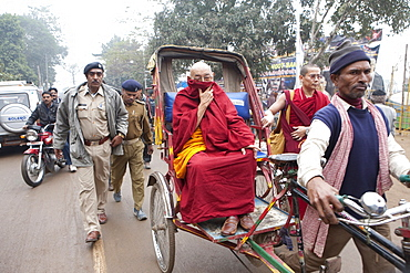 Tibetan monk take rickshaw to the main temple in bodhgaya. Kalachakra initiation in bodhgaya, bihar, india