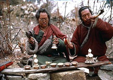 Nepal. Sonam & boom praying at charnel grounds. Humla. Vajrayana is tantric mahasiddha, lives fearlessly in terrifying places like remote jungles charnel grounds. nyingma lamas perform ritual at cremation grounds. lama rattles damaru, a small ritual drum to have origins in - shamanism. damaru, used as a tantric device to summon gods ward evil spirits, once made from human skull bones dried human skin as a reminder of impermanence of body. other lama, boom blows a kangling, a human thigh-bone horn. kangling is used in exorcism is capable of gods demons. Traditionally, best bones a kangling come from brahmans, particularly sixteen-year- brahman girls-or from tigers