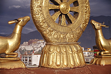 Potala palace seen through dharma chakra wheel from jhkokhang roof. Tibet