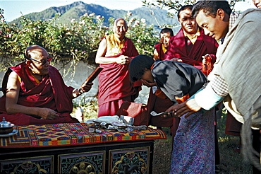 Trulshig rinpoche, blesses. Tulshig rinpoche blesses. Tulshig rimpoche s followers believe that he, like many other lamas, reassumes a human body after death in order to return to disciples. previous incarnation of tulshig rimpoche spent several years at dzarongpu monastery (highest monastery in world located at 16,500' within sight of northern side of mt everest) served as of ngawong tenzin teachers. He promised to return in next life, so at tulshig s death ngawong tenzin norbu sought found reincarnation. current tulshig rimpoche then came to monastery studied with ngawong tenzin norbu. relationship between teacher student, in which a teacher returns to study from former student, maintains lineage over generations. Bhutan