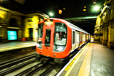 London Tube train in motion, London, England, United Kingdom, Europe