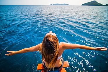 Girl on boat in Sumatra, Indonesia, Southeast Asia, Asia
