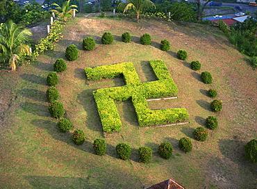 Symbol similar to swastika in garden of Buddhist temple Puu Jih Shih, Sandakan, Sabah, Malaysia, Southeast Asia, Asia