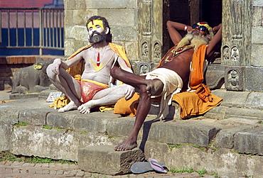 Holy men posing for photos Pashupatinath Temple, Kathmandu, Nepal, Asia
