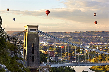 Clifton Suspension Bridge, with hot air balloons in the Bristol Balloon Fiesta in August, Clifton, Bristol, England, United Kingdom, Europe