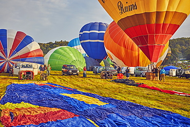 Hot-air balloons preparing to take off from the festival site during the annual Bristol International Balloon Fiesta, Bristol, England, United Kingdom, Europe