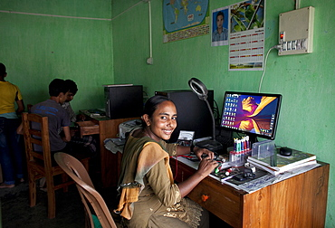 Habiba Akhter, aged 18, a member of a youth club in Afcalpur village, repairing mobile phones, Rangpur District of North West Bangladesh, Asia