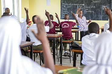 Teacher Rebecca Ngovano talks to students during a class taken with VSO volunteer Paul Jennings, Angaza school, Lindi, Tanzania, East Africa, Africa