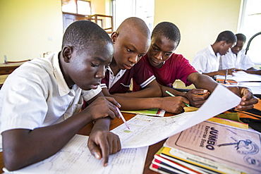 Children studying during a class taken by VSO volunteer Paul Jennings and local teacher Rebecca Ngovano, Angaza school, Lindi, Tanzania, East Africa, Africa