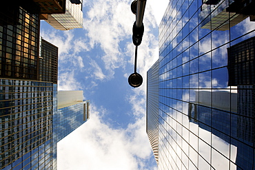 Looking up through skyscrapers, New York, United States of America, North America