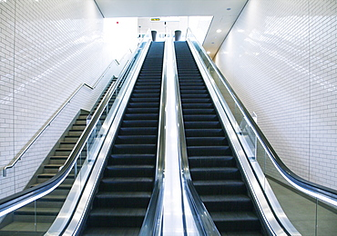 Tube station escalator and stairs, United Kingdom, Europe