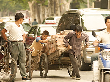 Busy street scene, showing the traditional and the new, Shanghai, China, Asia