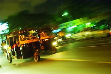 Speeding tuk-tuk at night, Mumbai (Bombay), India, South Asia