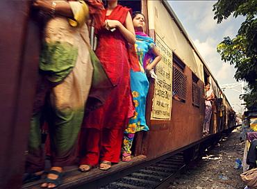 Commuters on a packed trains, Mumbai, Maharashtra, India, South Asia