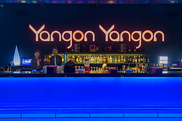 Young people enjoying the nightlife in a modern contemporary bar in Yangon (Rangoon), Myanmar (Burma), Asia
