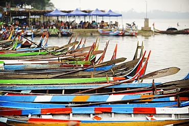 Brightly coloured boats at the U Bein Bridge, Taungthaman Lake, Amarapura near Mandalay, Myanmar (Burma), Asia