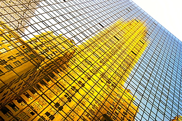 The Chrysler Building reflected in modern glass skyscraper, Lexington Avenue, New York, United States of America, North America