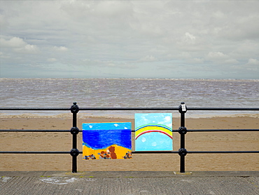 Optimistic paintings tied to railings on a drab British summer day, United Kingdom, Europe