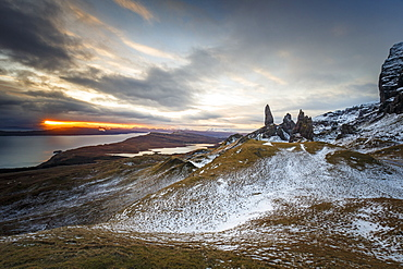 Sunrise breaks through on to a wintery landscape at the Old Man of Storr, Isle of Skye, Inner Hebrides, Scotland, United Kingdom, Europe