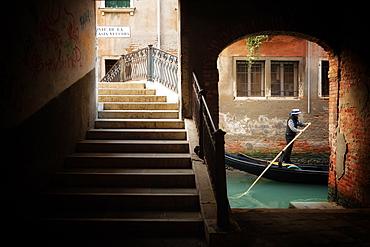 Gondolier by Ponte Della Malvasia Vecchia in Venice, Italy, Europe