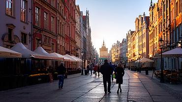Dlugi Targ Street looking towards the Golden Gate of Gdansk, Poland, Europe