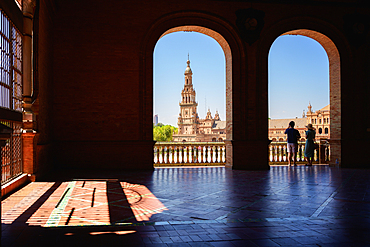 Tourists viewing the Plaza de Espana in Parque de Maria Luisa at night, Seville, Andalucia, Spain, Europe