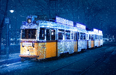 Budapest's Christmas Tram in a snow storm, Budapest, Hungary, Europe