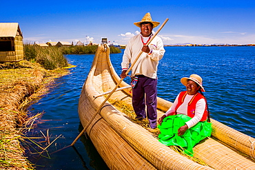 Quechua Indian couple on Floating Grass islands of Uros, Lake Titicaca, Peru, South America