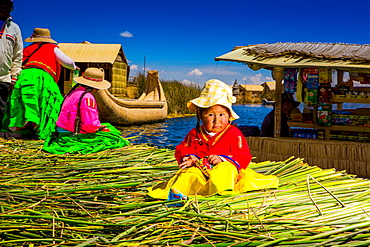 Little Quechua girl on Floating Grass islands of Uros, Lake Titicaca, Peru, South America