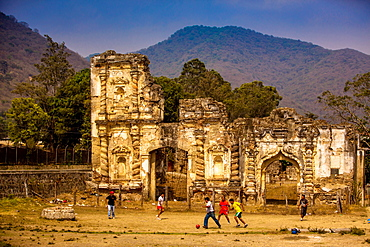 Kids playing soccer at ruins in Antigua, Guatemala, Central America