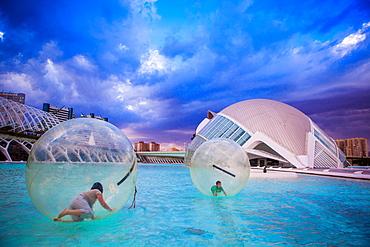 Kids playing in floating orbs, Hemispheric Buildings, City of Arts and Sciences, Valencia, Spain, Europe