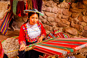 Quechua woman from the Accha Huata, Bombom, and Paucartambo communities working her loom, Sacred Valley, Peru, South America