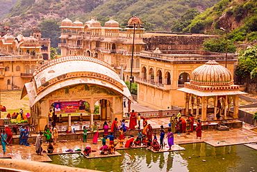 Women bathing in cistern, Jaipur, Rajasthan, India, Asia