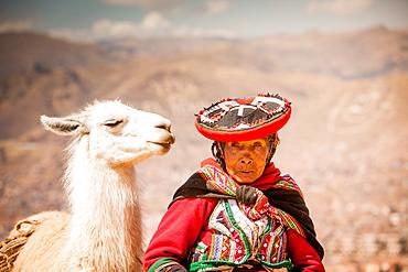 Traditional Peruvian woman and her llama, Cusco, Peru, South America