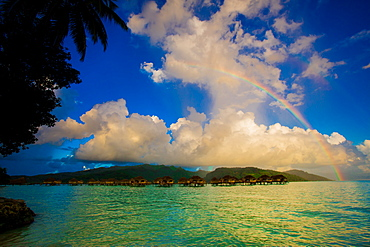 Rainbow arcing over the overwater bungalows, Le Taha'a Resort, Tahiti, French Polynesia, South Pacific, Pacific