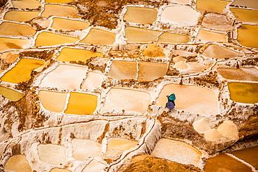 Woman mining salt, Salineras de Maras, Maras Salt Flats, Sacred Valley, Peru, South America