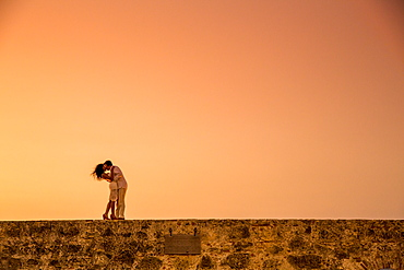 Couple posing on the old wall, Old Walled-in City, Cartagena, Colombia, South America