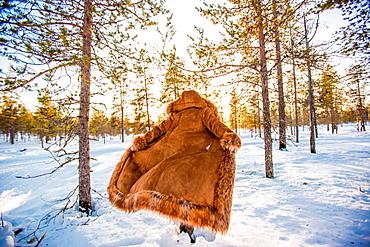 Woman in fur coat in the Arctic Wilderness, Kakslauttanen Igloo West Village, Saariselka, Finland, Scandinavia, Europe