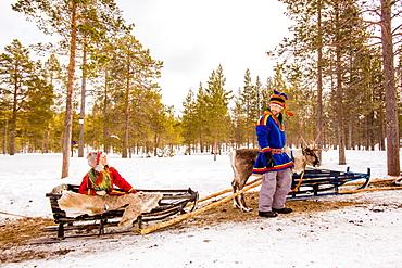 Couple wearing Traditional Sami costumes, Reindeer Safari, Kakslauttanen Igloo Village, Saariselka, Finland, Scandinavia, Europe