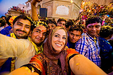 Laura Grier selfie in the crowd during the Flower Holi Festival, Vrindavan, Uttar Pradesh, India, Asia