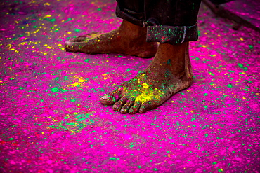 Man's bare feet during the color pigment throwing festival, Holi Festival, Vrindavan, Uttar Pradesh, India, Asia